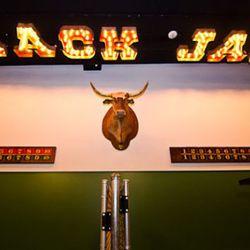 A Black Jack sign hangs over the bocce court.