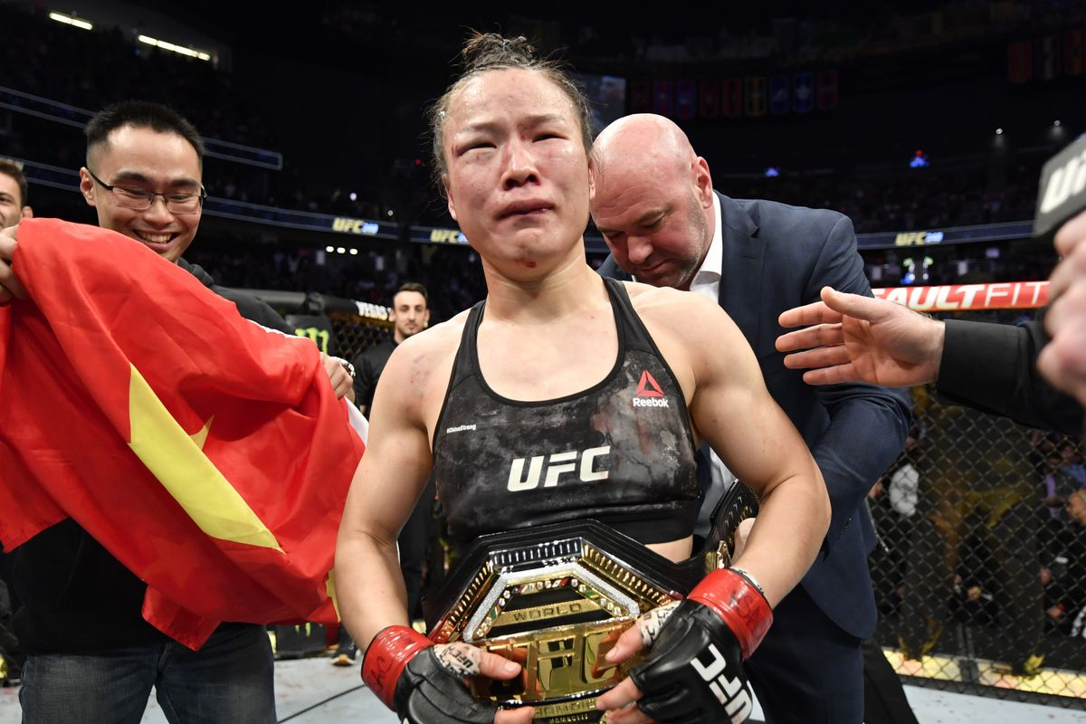 Zhang Weili of China celebrates after her split-decision victory over Joanna Jedrzejczyk of Poland in their UFC strawweight championship fight during the UFC 248 event at T-Mobile Arena on March 07, 2020 in Las Vegas, Nevada.