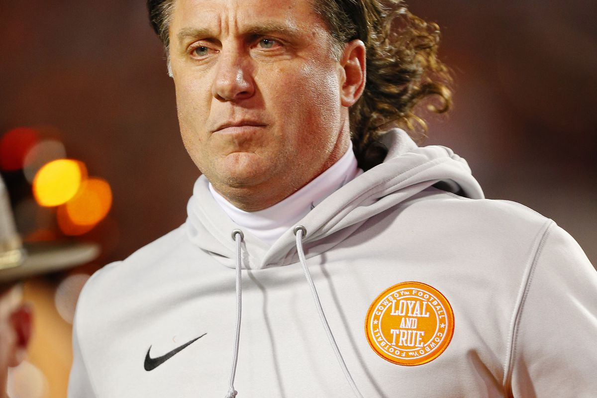 Head coach Mike Gundy of the Oklahoma State Cowboys runs onto the field for a Bedlam game against the Oklahoma Sooners on November 30, 2019 at Boone Pickens Stadium in Stillwater, Oklahoma. OU won 34-16.