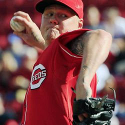 Cincinnati Reds starting pitcher Mat Latos throws against the Los Angeles Dodgers in the first inning of a baseball game on Saturday, Sept. 22, 2012, in Cincinnati.