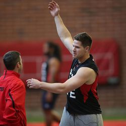 Utah's Jake Murphy stretches as NFL hopefuls work out for pro scouts during Utah pro football day at the University of Utah Wednesday, March 19, 2014, in Salt Lake City.