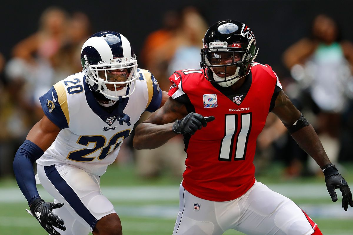 Jalen Ramsey of the Los Angeles Rams defends against Julio Jones of the Atlanta Falcons in the first half at Mercedes-Benz Stadium on October 20, 2019 in Atlanta, Georgia.