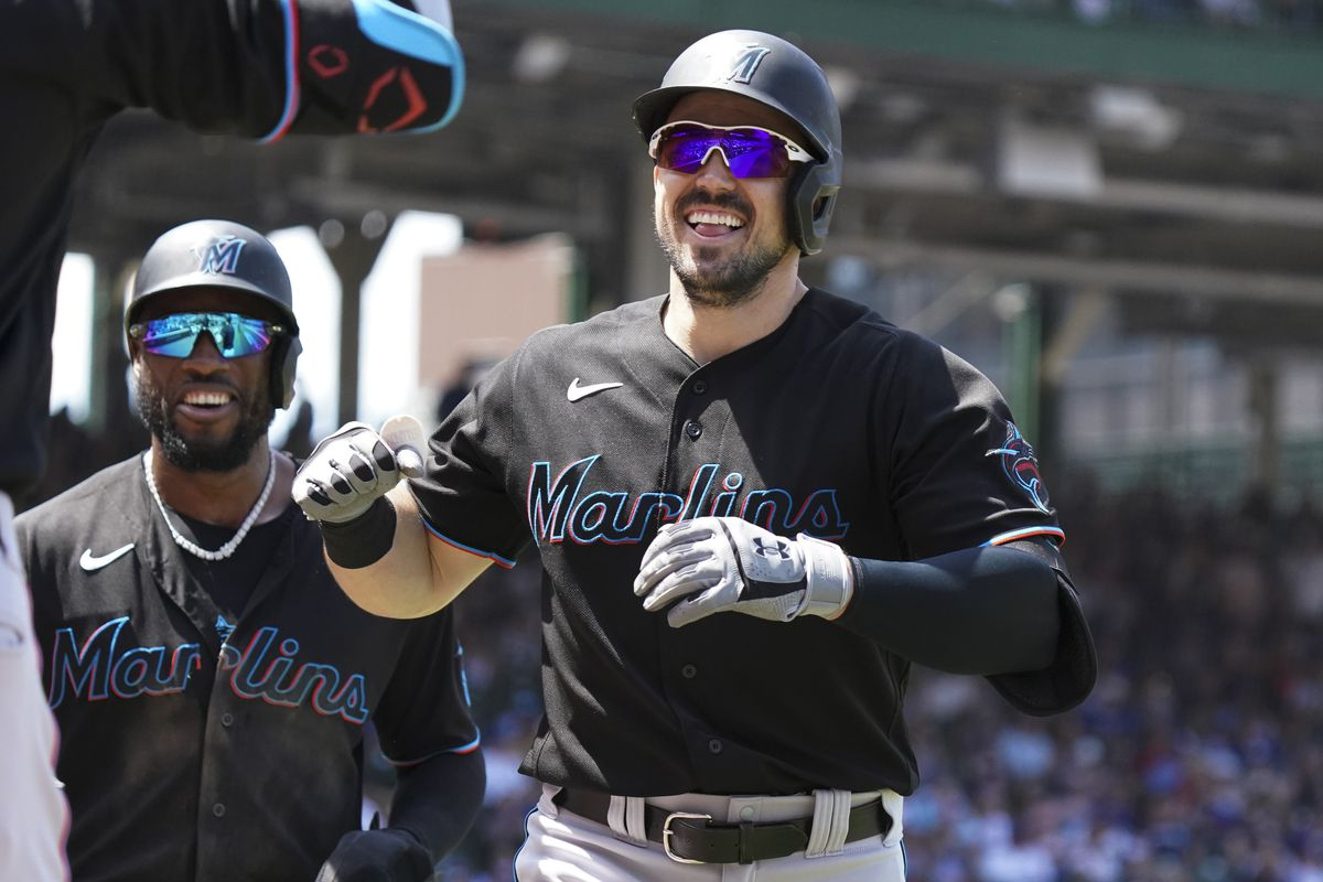 Adam Duvall #14 of the Miami Marlins reacts after two-run home run during the third inning of a game against the Chicago Cubs at Wrigley Field