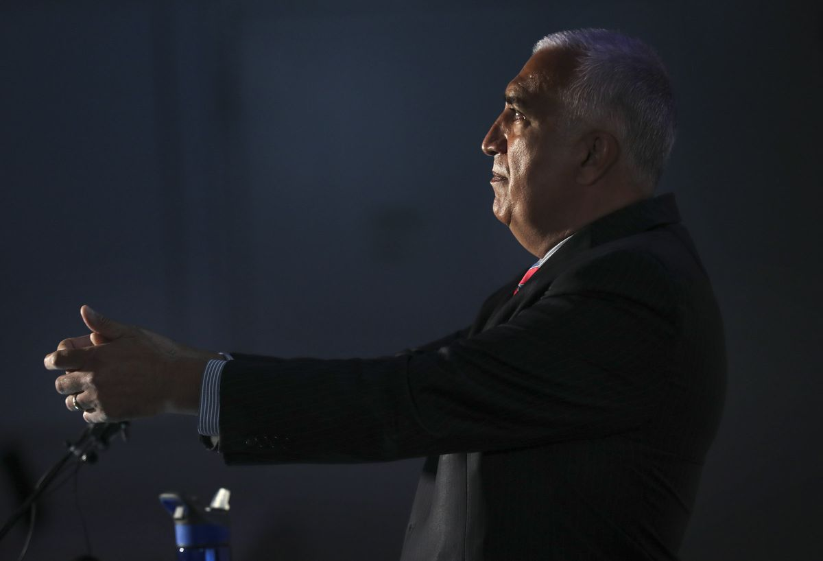Salt Lake County District Attorney Sim Gill raises his hands as he shows reporters how police raised their guns prior to shooting Bernardo Palacios-Carbajal on May 23 as police body camera footage is shown during a press conference at the district attorney office building in Salt Lake City on Thursday, July 9, 2020. Gill said the officer's use of deadly force was justified.