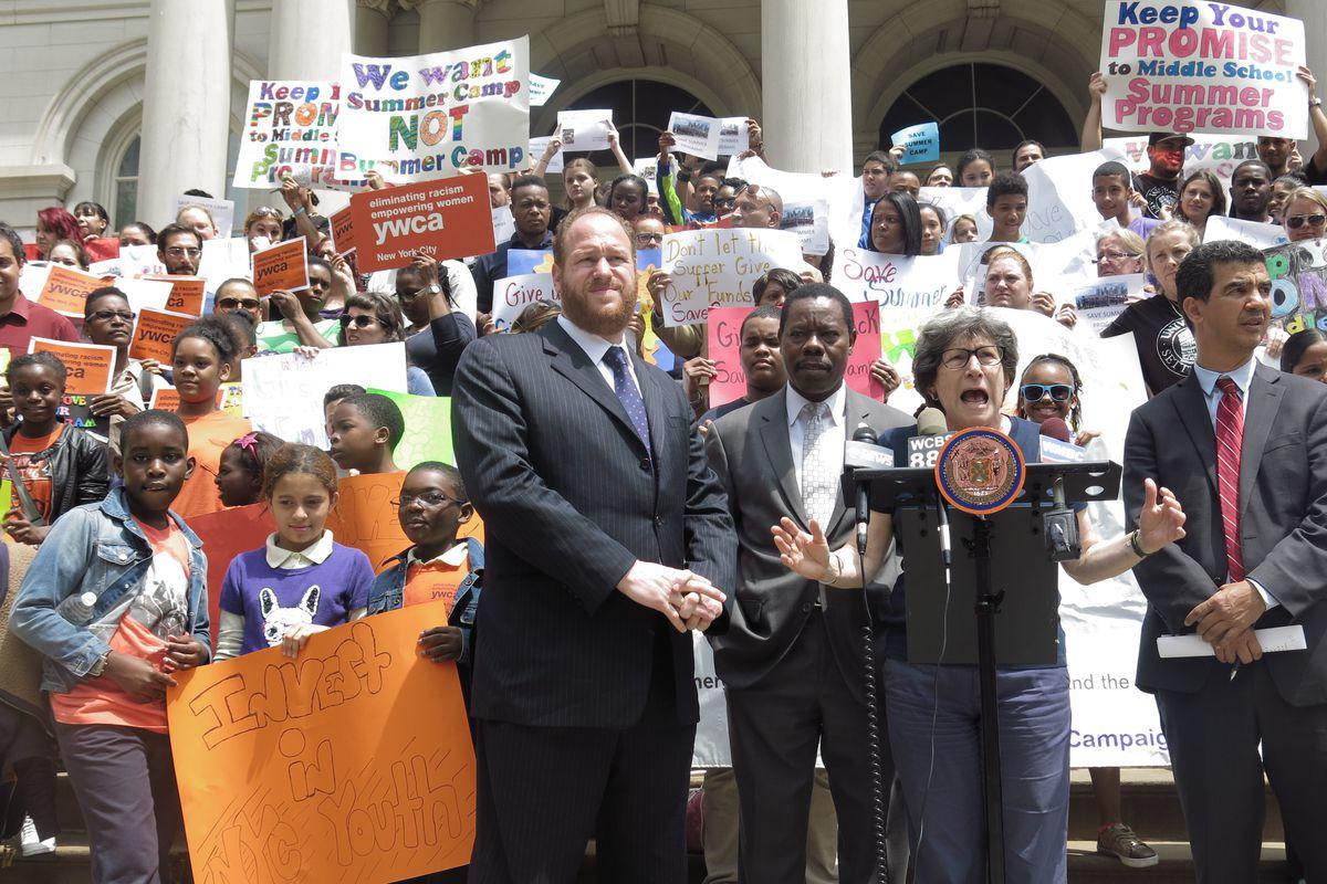 Summer program providers rallied outside City Hall on Thursday.