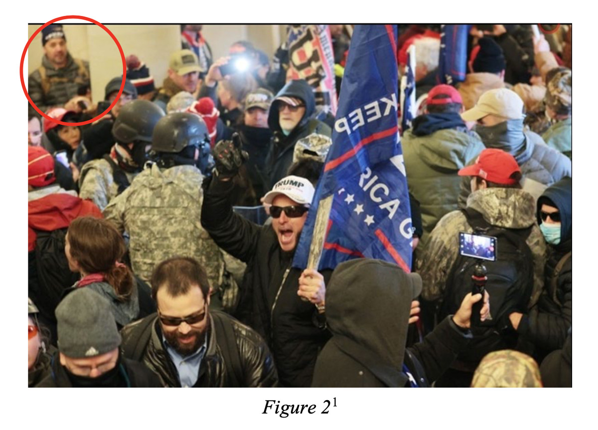In a screenshot from Michael Hardin's federal complaint, a photo posted online by TMZ and sent to the FBI by a tipster shows a man the tipster says is Hardin, circled in red, in a crowd of people inside the Capitol Crypt in Washington on Jan. 6, 2021.