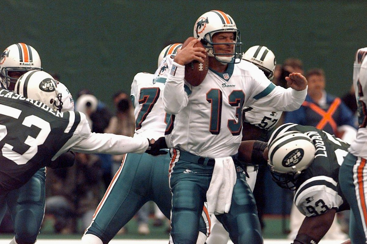 Miami Dolphins' quarterback Dan Marino is about to be sacked