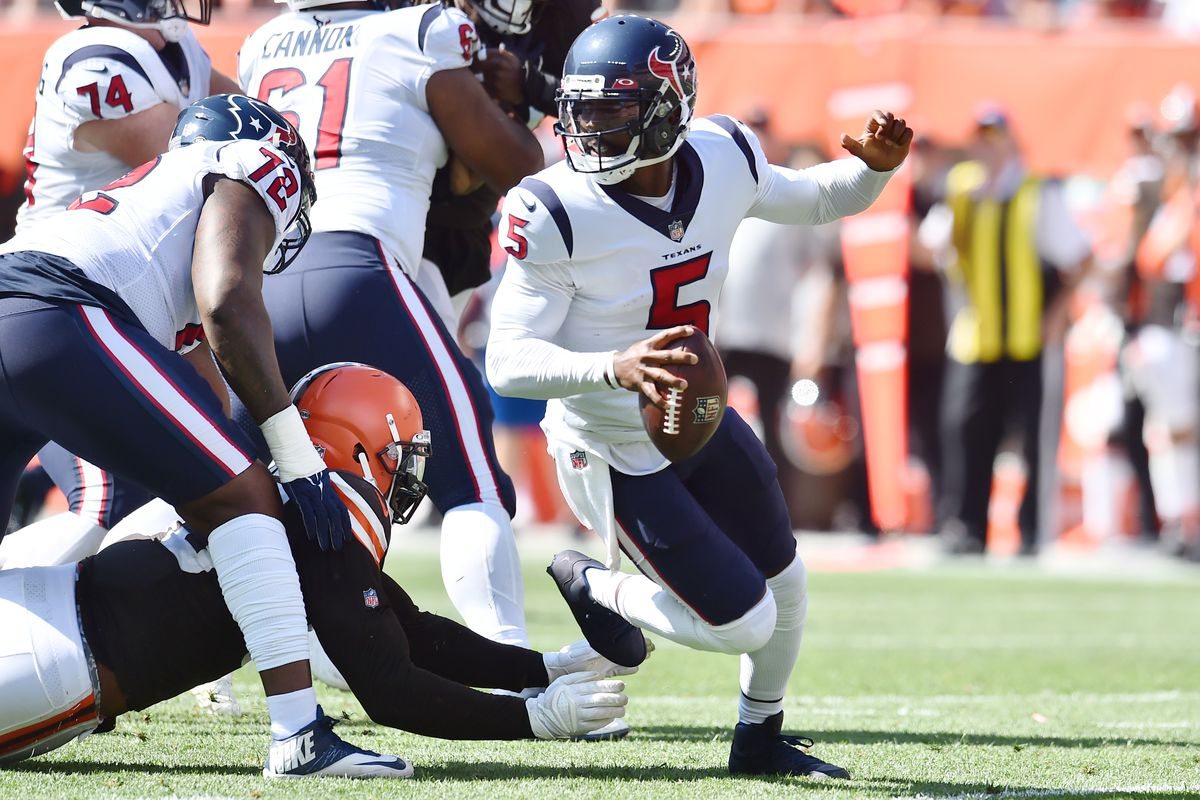 Houston Texans quarterback Tyrod Taylor (5) scrambles from the Cleveland Browns defense during the first half at FirstEnergy Stadium.