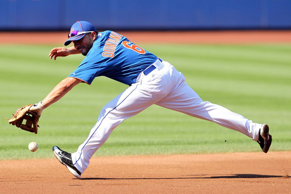 July 6, 2012; New York, NY, USA; New York Mets infielder Omar Quintanilla (6) chases down a ground ball during infield drills before a game against the Chicago Cubs at Citi Field. Mandatory Credit: Brad Penner-US PRESSWIRE