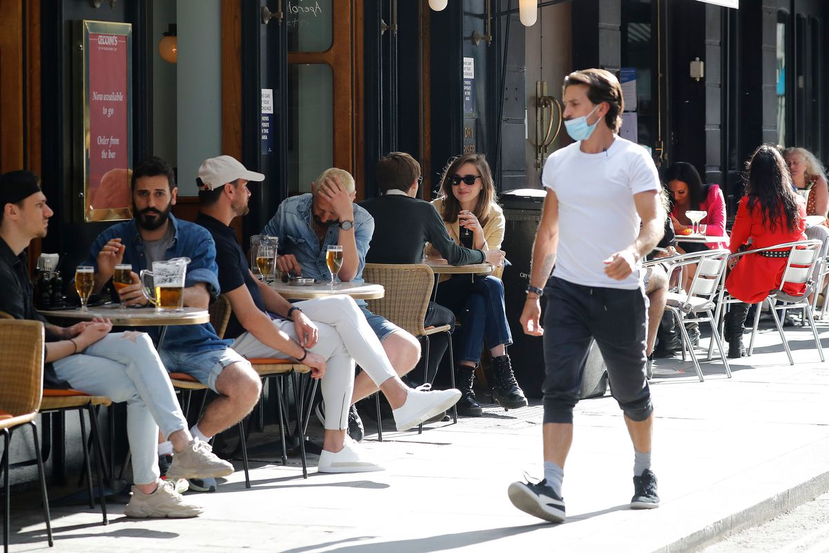 London restaurants outdoors in the sunshine during the Eat Out to Help Out scheme after coronavirus