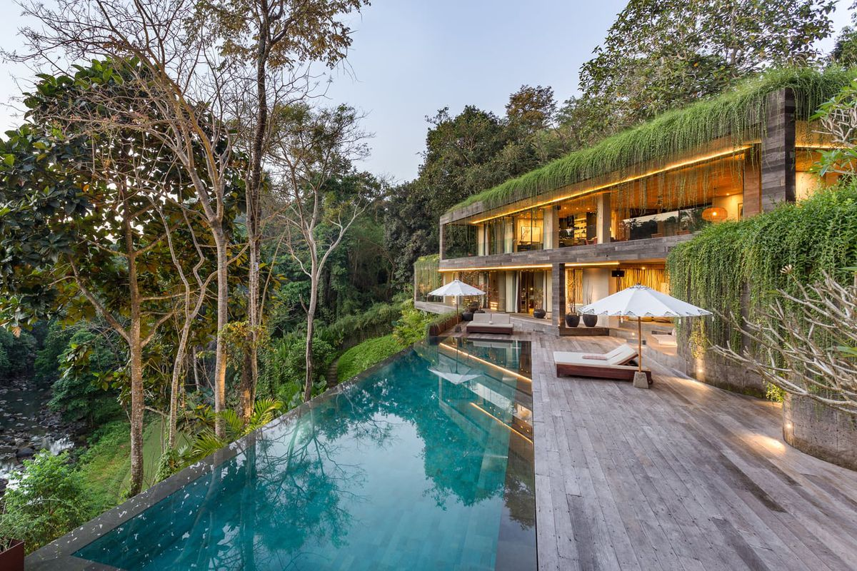 Concrete villa with greenery on the roof