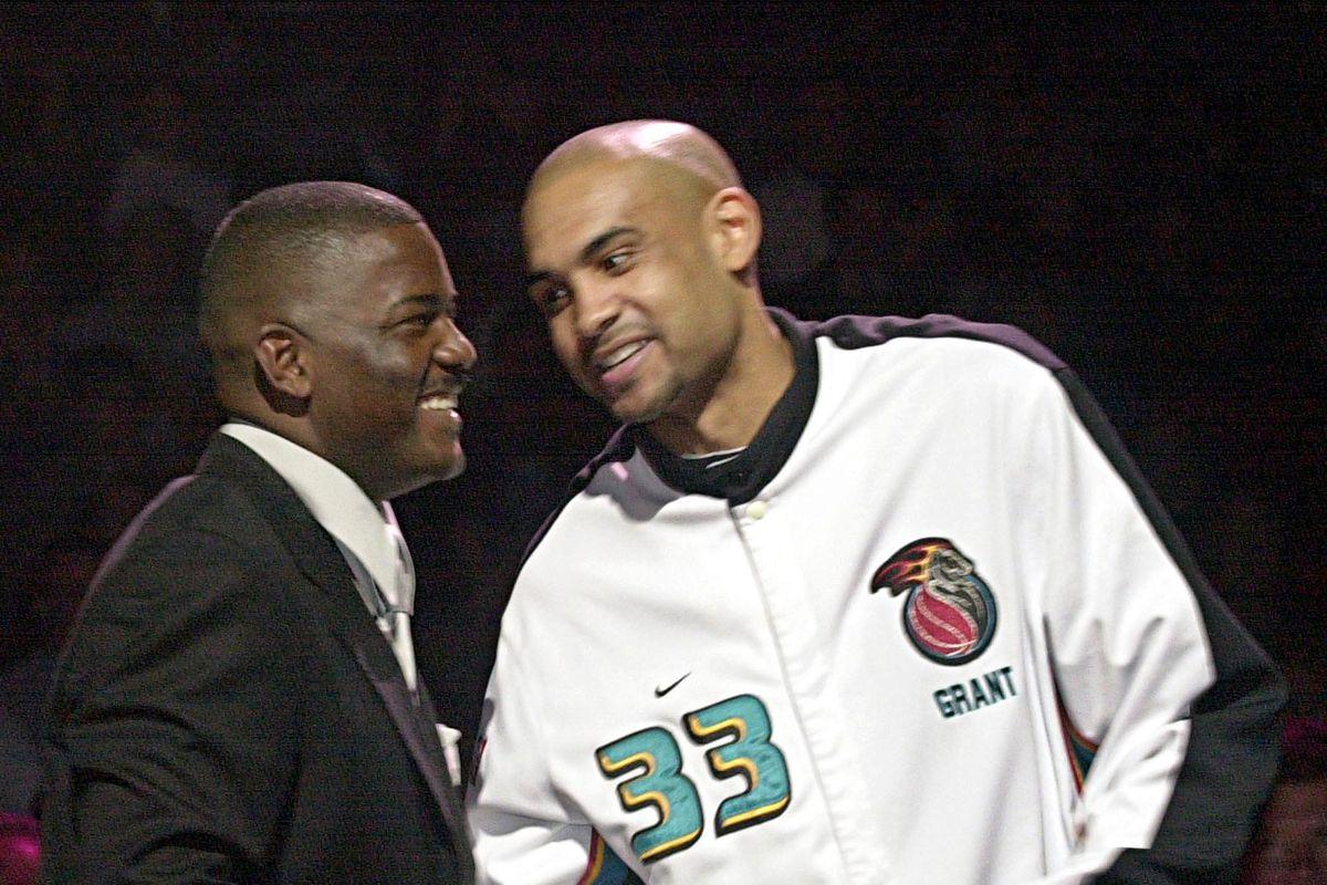 Former Detroit Pistons Joe Dumars (L) gets a hands