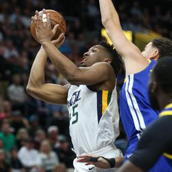 Utah Jazz guard Donovan Mitchell (45) goes to the hoop during the game against the Golden State Warriors at Vivint Arena in Salt Lake City on Tuesday, April 10, 2018.