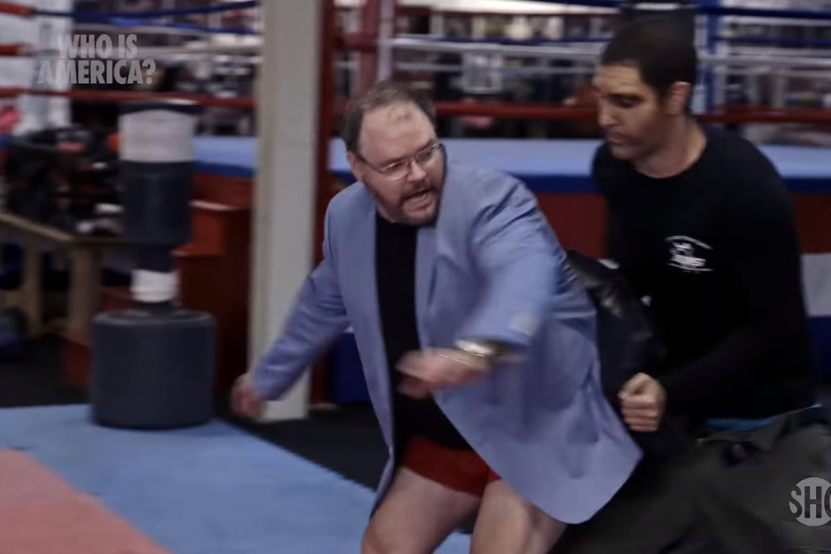 Georgia state Rep. Jason Spencer (R) charges at Sacha Baron Cohen, who was posing as an Israeli security expert, during a segment on Showtime's Who Is America? aired on July 22.