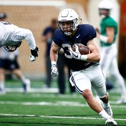 BYU running back Zachary Katoa runs with the ball during the Cougars' practice in the Indoor Practice Facility on Thursday, March 15, 2018 in Provo.
