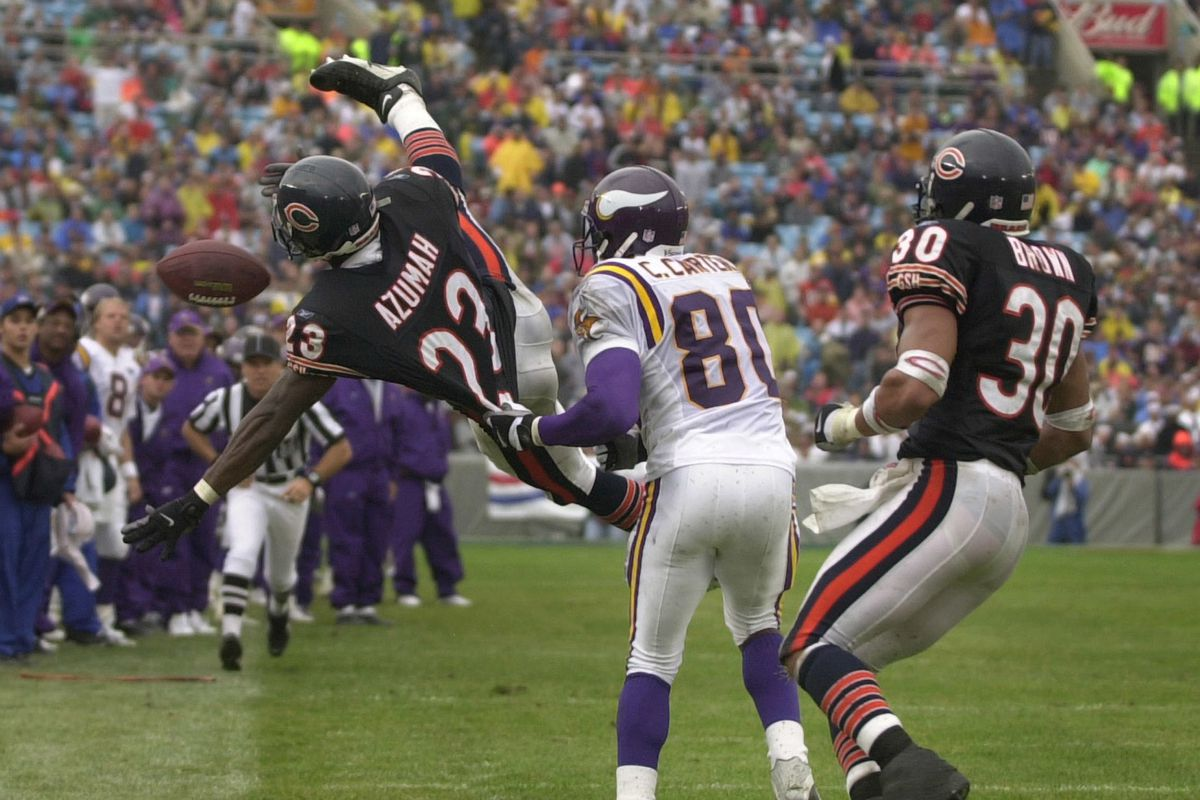 Chicago IL 9/23/01 Vikings at Chicago Bears-----Minnesota Viking Cris Carter is call for offensive pass interference as he tugs on Bears Jerry Azumah (23)jersey ) and pushes him out of bound during Sunday NFL action at Solider Field. Mike Brown of Chica