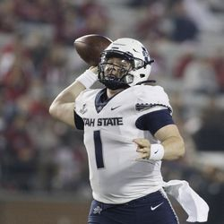 Utah State quarterback Logan Bonner throws a pass during the second half of an NCAA college football game against Washington State, Saturday, Sept. 4, 2021, in Pullman, Wash. Utah State won 26-23.