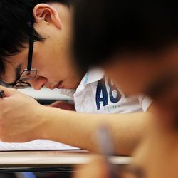 Student John Bergerson takes a test in Syd Lott's IB Economics class at Skyline High School in Salt Lake City, Tuesday, Oct. 20, 2015.