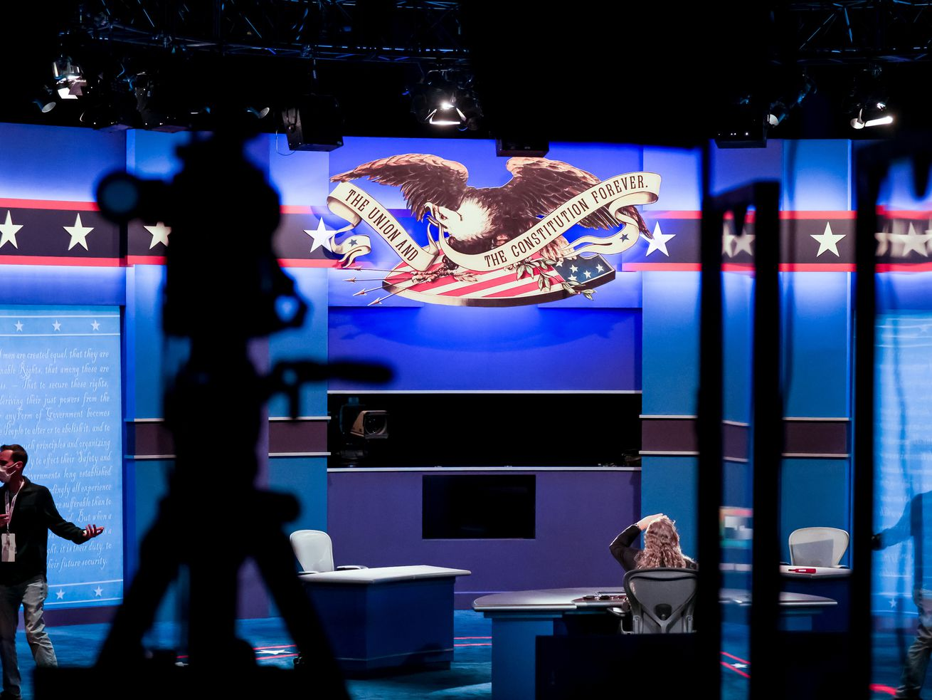 Crews put finishing touches on the stage at Kingsbury Hall at the University of Utah in Salt Lake City on Tuesday, Oct. 6, 2020, in preparation for Wednesday's vice presidential debate.