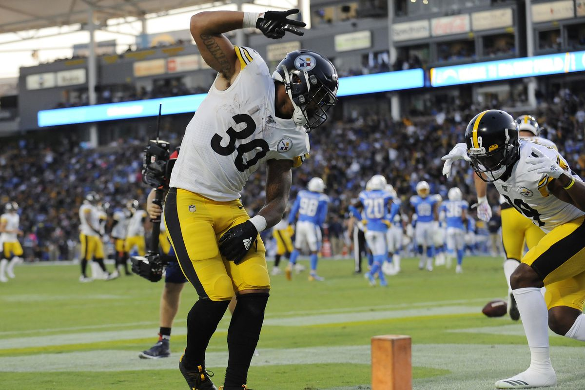 Pittsburgh Steelers running back James Conner celebrates with wide receiver JuJu Smith-Schuster his touchdown scored against the Los Angeles Chargers during the first half at Dignity Health Sports Park.