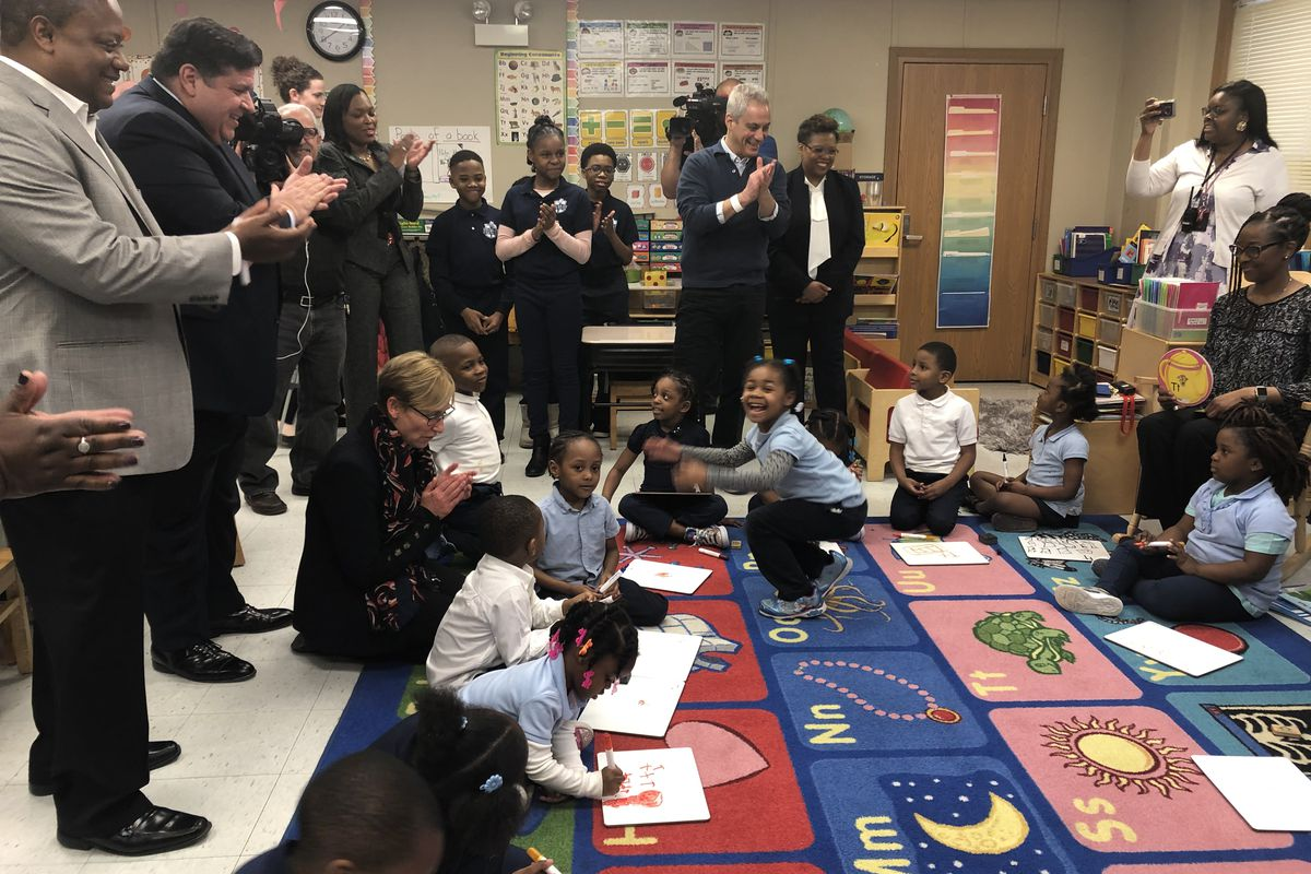 Illinois Gov. J.B. Pritzker, second from left, Chicago schools chief Janice Jackson and Mayor Rahm Emanuel, in front of TV camera, visit a pre-kindergarten classroom at John T. Pirie Fine Arts and Academic Center on March 22, 2019. Emanuel announced an expansion of preschool and day care.