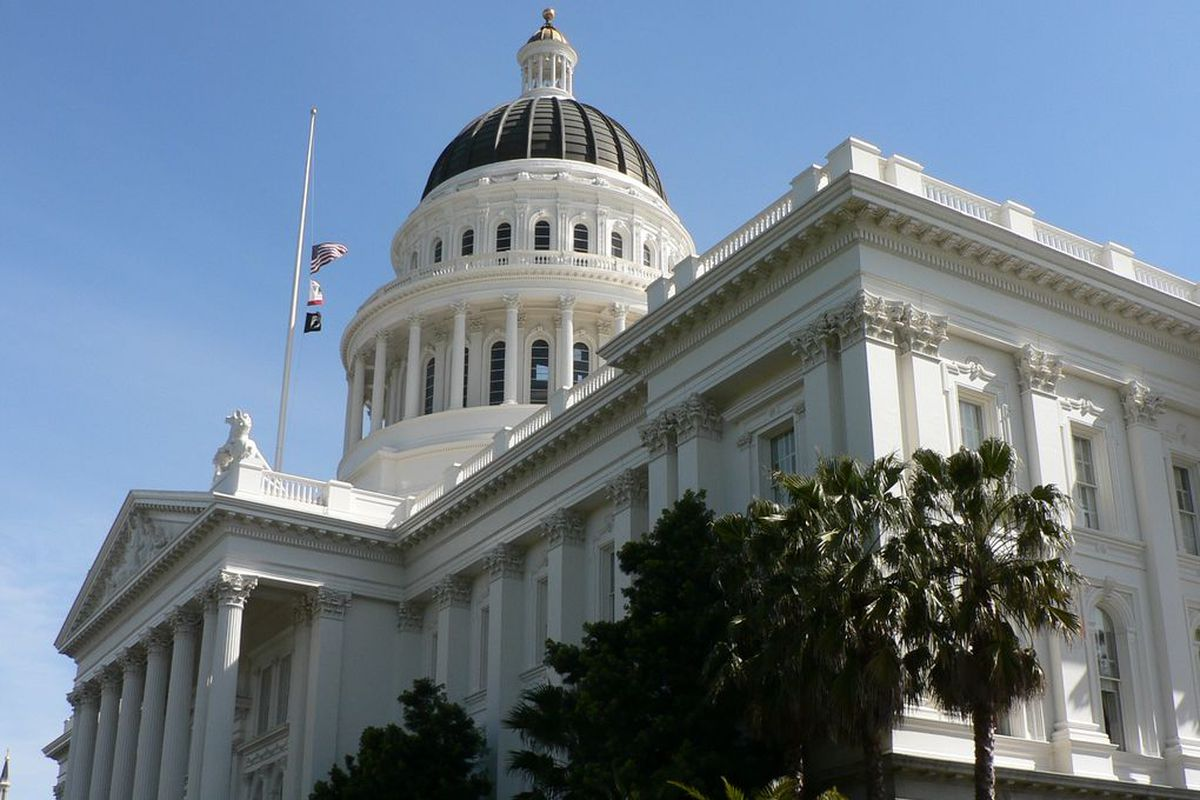 An extremely low-angle photo of the dome of the Capitol building in Sacramento.