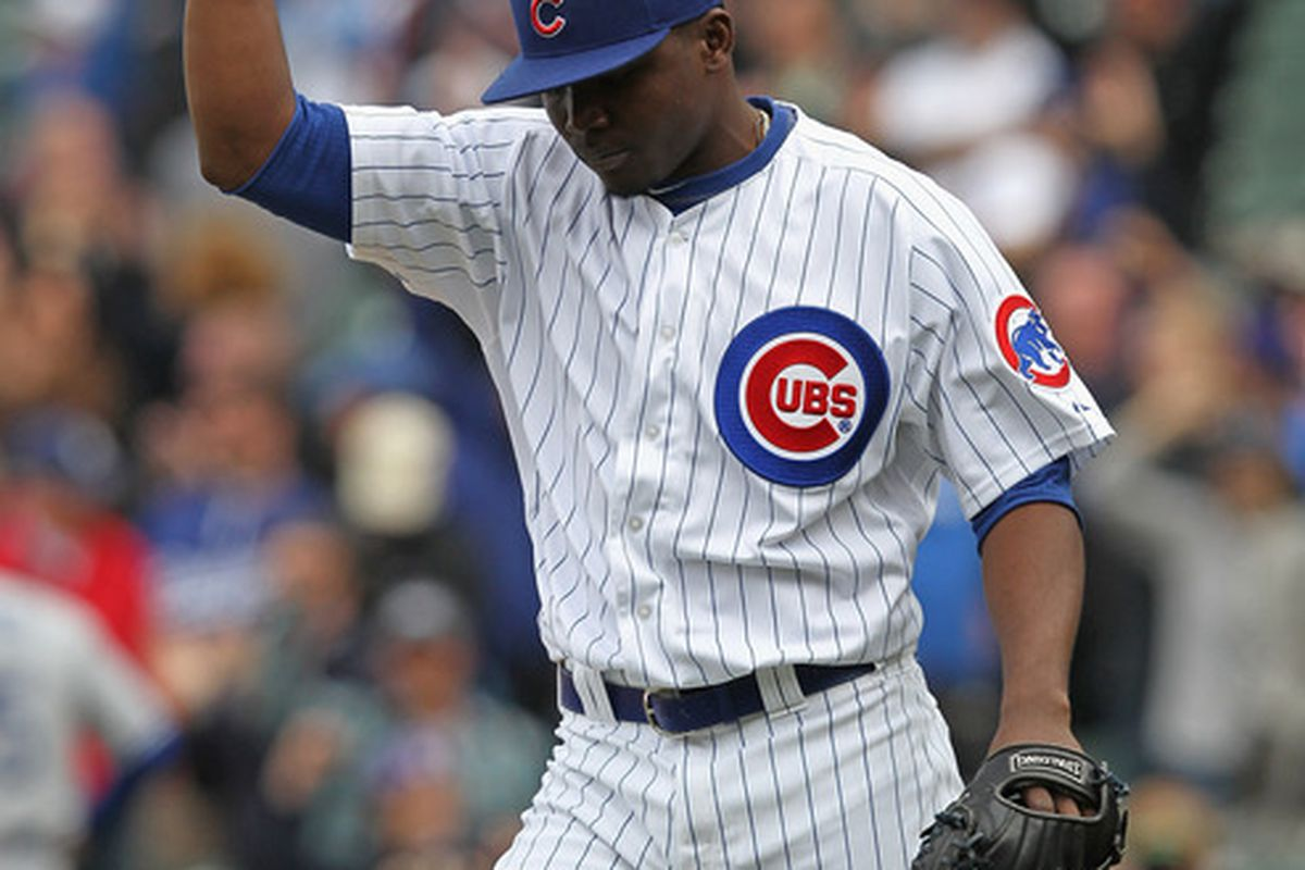 Rafael Dolis of the Chicago Cubs celebrates a save and a win against the Los Angeles Dodgers at Wrigley Field in Chicago, Illinois. The Cubs defeated the Dodgers 5-4.  (Photo by Jonathan Daniel/Getty Images)