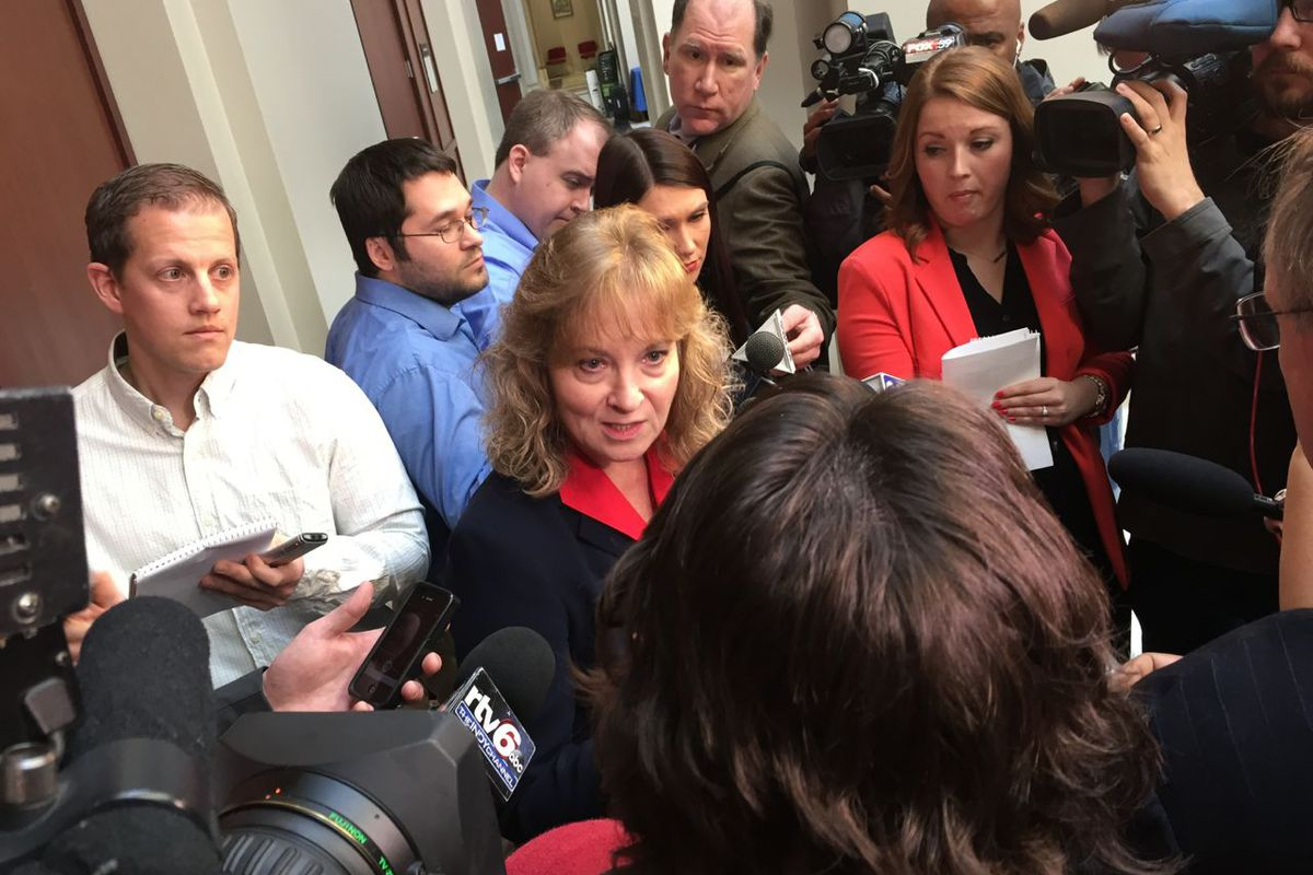 State Superintendent Glenda Ritz is surrounded by reporters after an Indiana State Board of Education meeting last year.