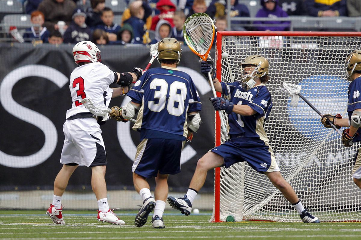 Apr 1, 2012; East Rutherford, NJ, USA;  St. Johns Red Storm midfield Ryan Fitzgerald (3) scores goal against Notre Dame Fighting Irish goalie John Kemp (1) at the Big City Classic at MetLife Stadium. Mandatory Credit: Jim O'Connor-US PRESSWIRE