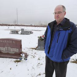 Ken Warhola reflects on the deaths of his children, James, 8, and Jean Marie, 7, near their graves at Lindquist Memorial Park in Layton on Wednesday, Jan. 29, 2020. Prosecutors say the children were strangled by their mother more than nine years ago.
