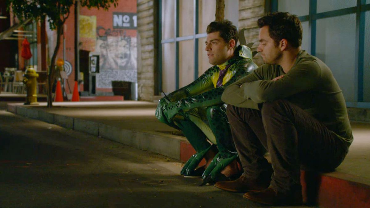 Nick and Schmidt sit on a curb