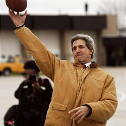 Sen. John Kerry, D-Mass., throws football before flying out of Green Bay, Wis. Kerry traveled to Nevada where he spoke to undecided voters in Spanish and English.