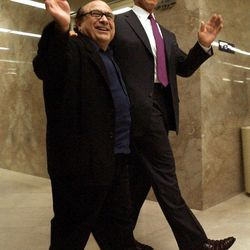 """FILE --  In this April 15, 2004 file photo, Actor Danny DeVito, left, waves as he walks through the Capitol with long-time friend, movie co-star and current Governor of California, Arnold Schwarzenegger, in Sacramento, Calif.  Schwarzenegger, who came to office during California's historic 2003 recall election, will  soon be releasing his autobiography, """"Total Recall: My Unbelievably True Life Story."""""""