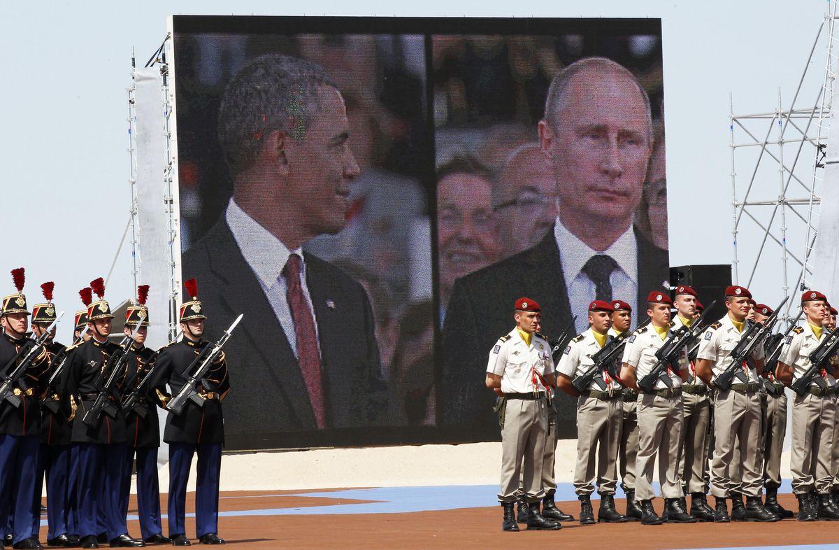 obama putin CHRISTOPHE ENA/AFP/Getty Images
