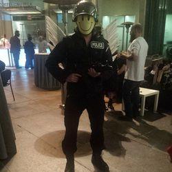 """Jay Sparich as Banksy's """"Smiley Riot Cop."""""""