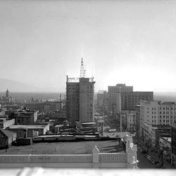 View from the Hotel Utah in 1945 shows a busy Main Street and the tower atop the Walker Building with the City-County Building on the left in the background.