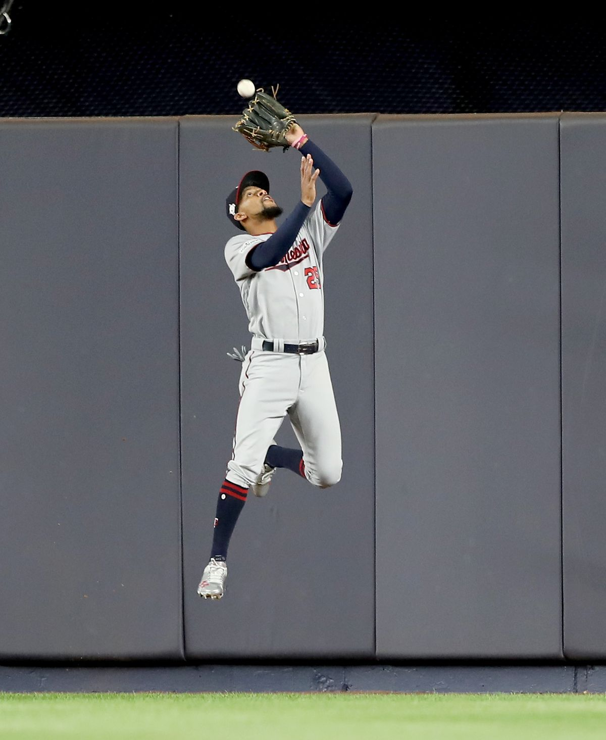 Byron Buxton jumps to catch a ball on the warning track
