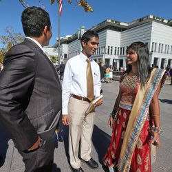 Naveen Sunvarajan, Jason Sedtely and Aretss Sedtely, left to right, from India, before the afternoon session of the 183rd Semiannual  General Conference of the Church of Jesus Christ of Latter-day Saints Sunday, Oct. 6, 2013, in Salt Lake City.
