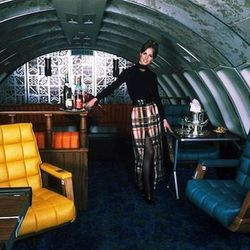 """A luxury flight called for even more plaid in the 70s. Photo via <a href-""""http://www.uahf.org/ua_flight_attendants_fashions.asp"""">UAHF.org.</a>"""