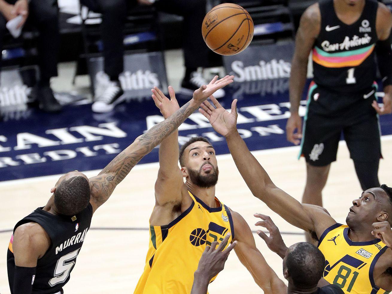 San Antonio Spurs guard Dejounte Murray (5), Utah Jazz center Rudy Gobert (27) and Utah Jazz guard Miye Oni (81) reach for the rebound during an NBA game at Vivint Smart Home Arena in Salt Lake City on Monday, May 3, 2021. The Jazz won 110-99.