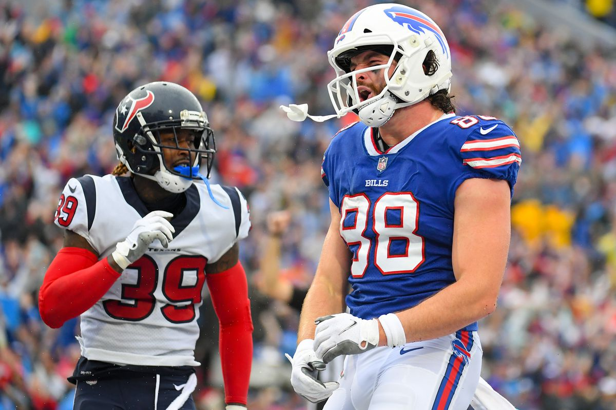 Buffalo Bills tight end Dawson Knox (88) reacts to his touchdown catch and run as Houston Texans cornerback Terrance Mitchell (39) looks on during the first half at Highmark Stadium.