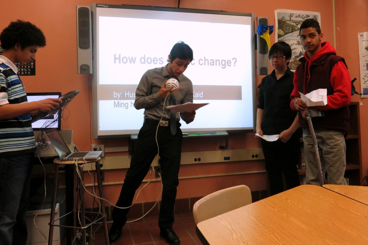 Brooklyn International High School students perform a song using an instrument they made from a clock.