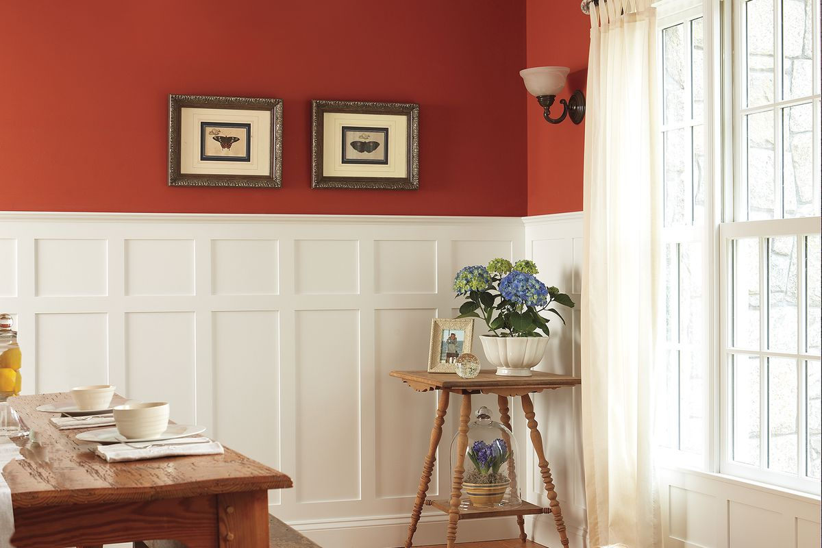 Maroon and white dining room wainscoting