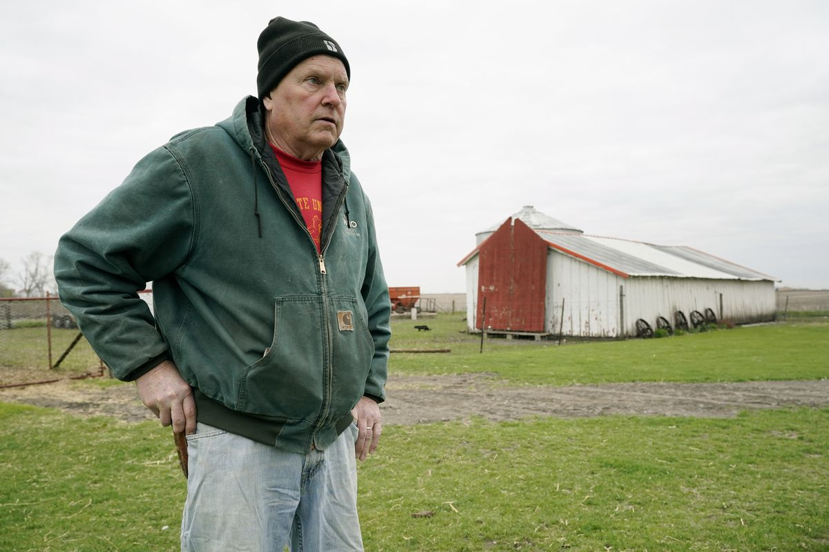 Morey Hill stands near an outbuilding as he speaks about his farming operation, Friday, April 16, 2021, near Madrid, Iowa.
