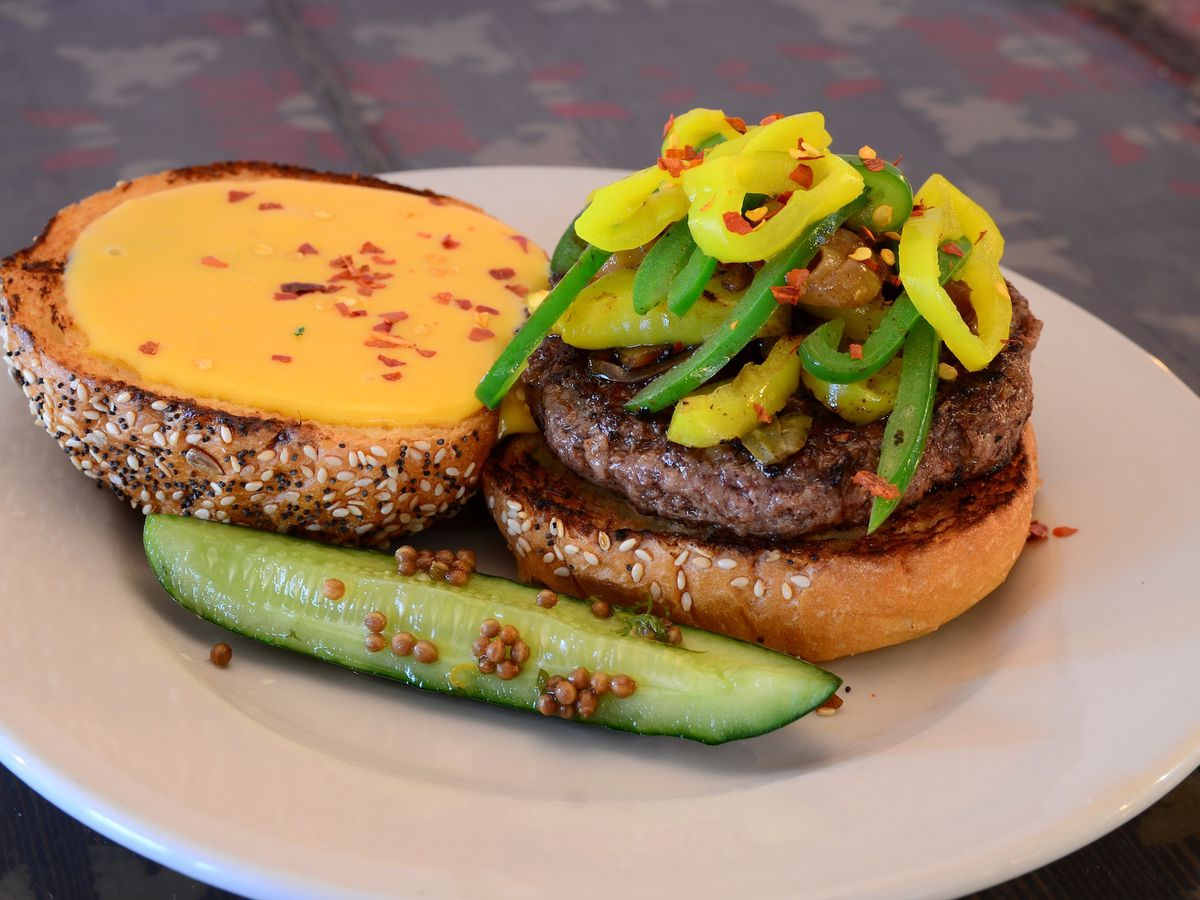Burger topped with peppers and cheese
