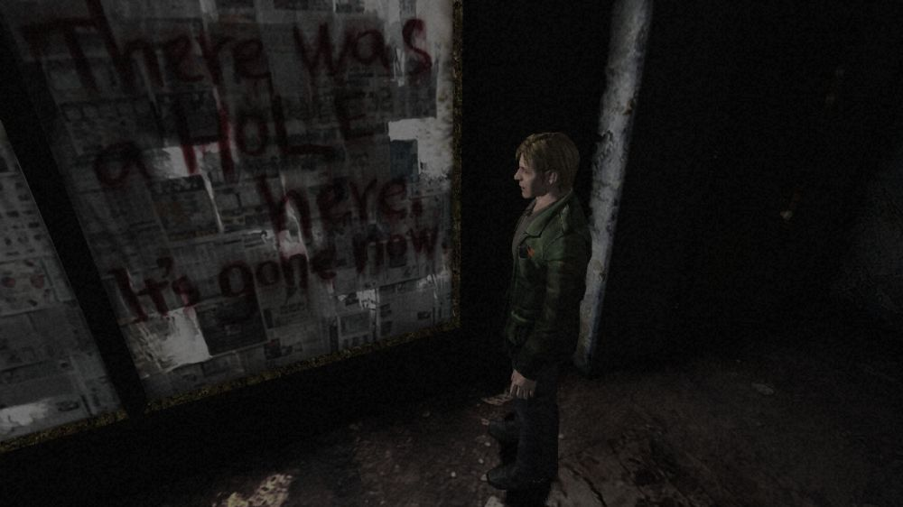 James looks at a message on a wall