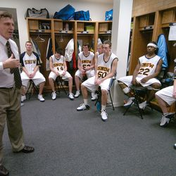 Snow College coach Roger Reid congratulates his basketball team after defeating Salt Lake Community College in Ephraim on Jan. 28, 2006.
