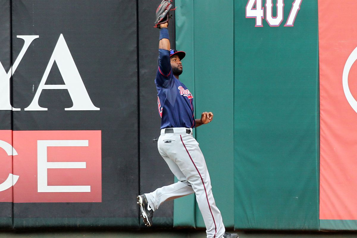 ARLINGTON, TX - AUGUST 26: Denard Span #2 of the Minnesota Twins runs down the fly ball by Adrian Beltre #29 of the Texas Rangers on August 26, 2012 at the Rangers Ballpark in Arlington in Arlington, Texas. (Photo by Layne Murdoch/Getty Images)