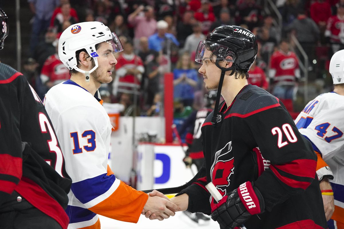 May 3, 2019; Raleigh, NC, USA; Carolina Hurricanes center Sebastian Aho and New York Islanders shake hands after game four of the second round of the 2019 Stanley Cup Playoffs at PNC Arena. The Carolina Hurricanes defeated the New York Islanders 5-2.