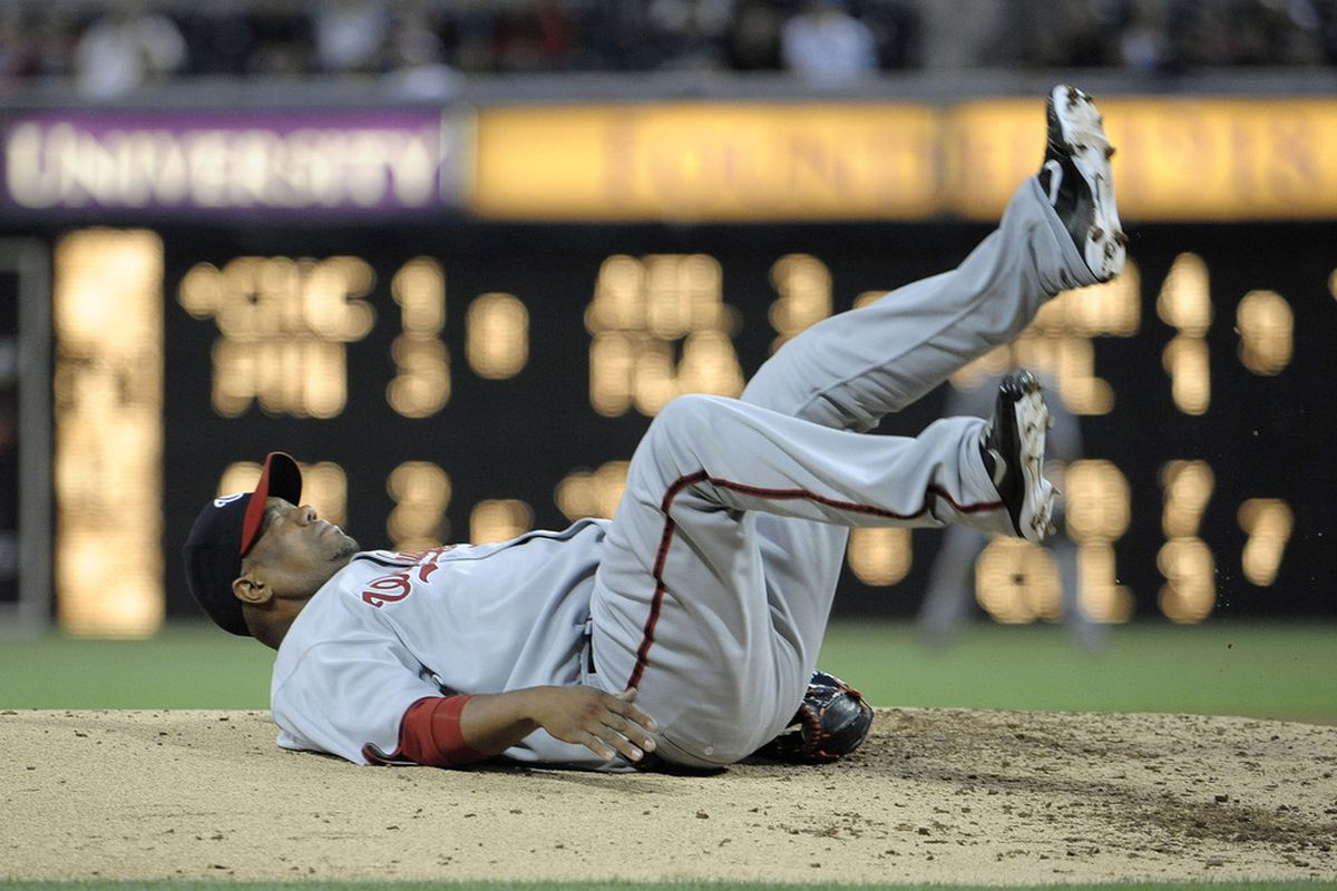 """Livan Hernandez #61 of the Washington Nationals doesn't quite understand the """"planking"""" phenomenon, but he picked a good place to try it...(Photo by Denis Poroy/Getty Images)"""